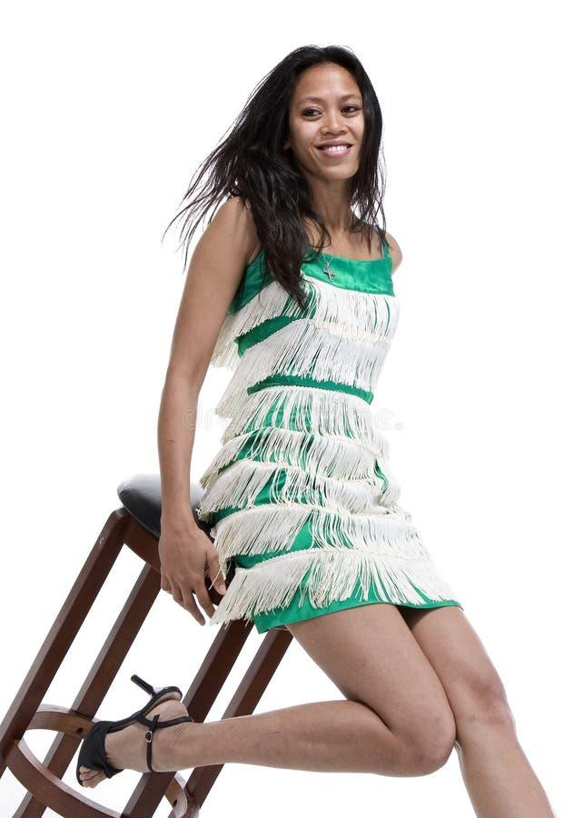 Brunette in vestito dall'annata immagine stock