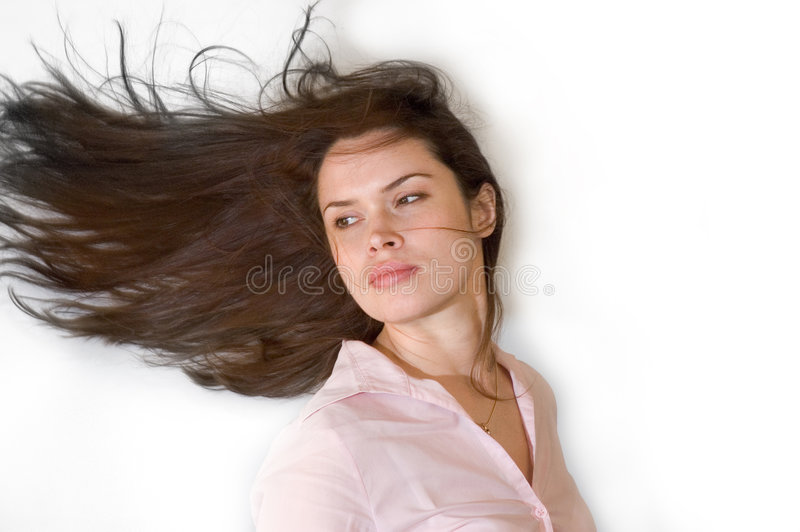 Brunette with waving hair royalty free stock photography