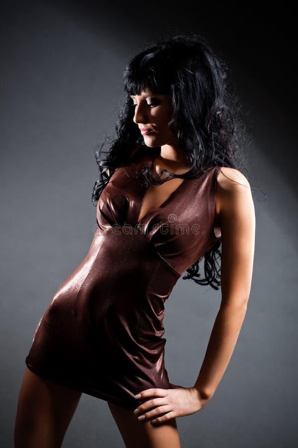 Brunette wearing brown dress stock photos