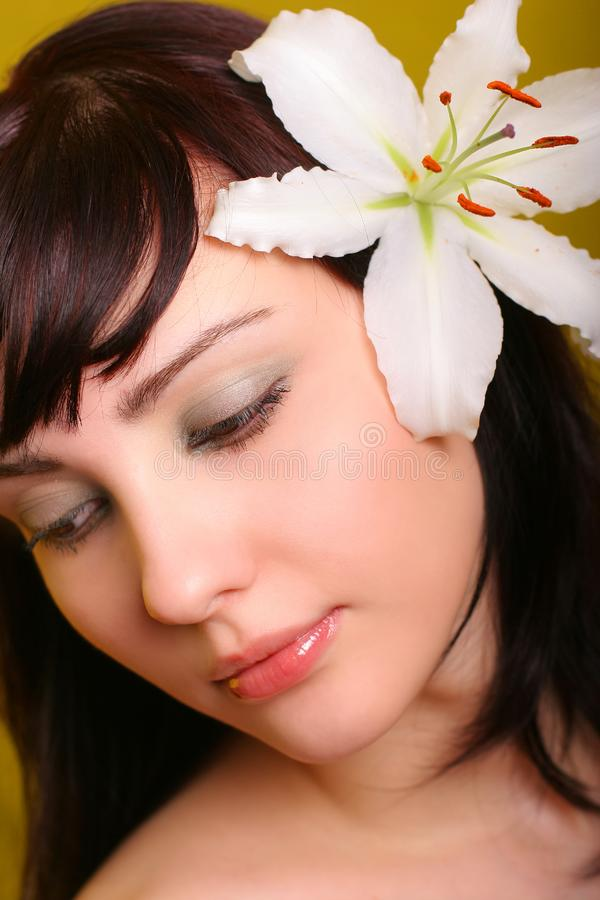 Brunette with white lily flowers royalty free stock photo