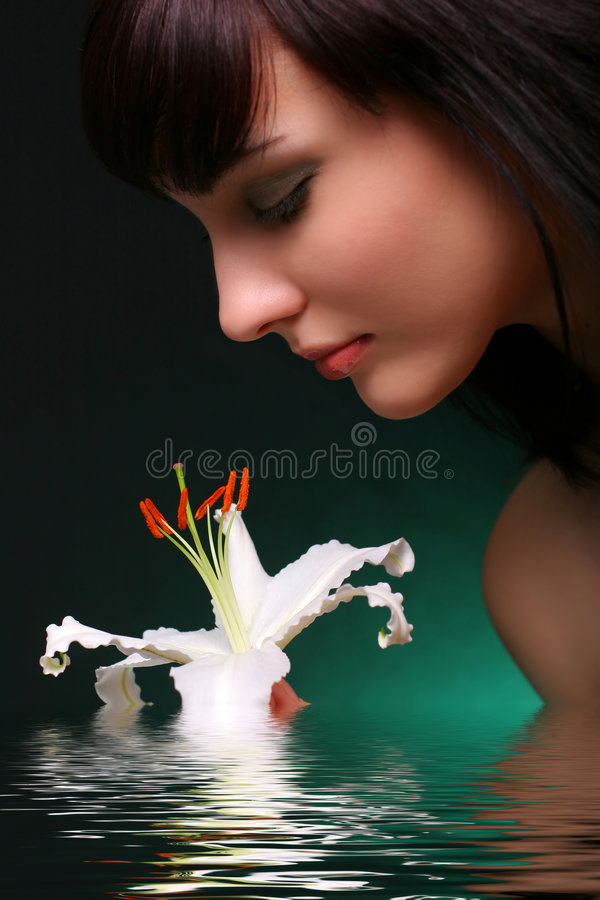 Download Brunette With White Lily Flowers In Water Stock Photo - Image: 1943608