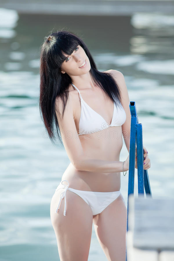 Download Brunette In White On Open Air Stock Image - Image of dark, ladder: 29349215