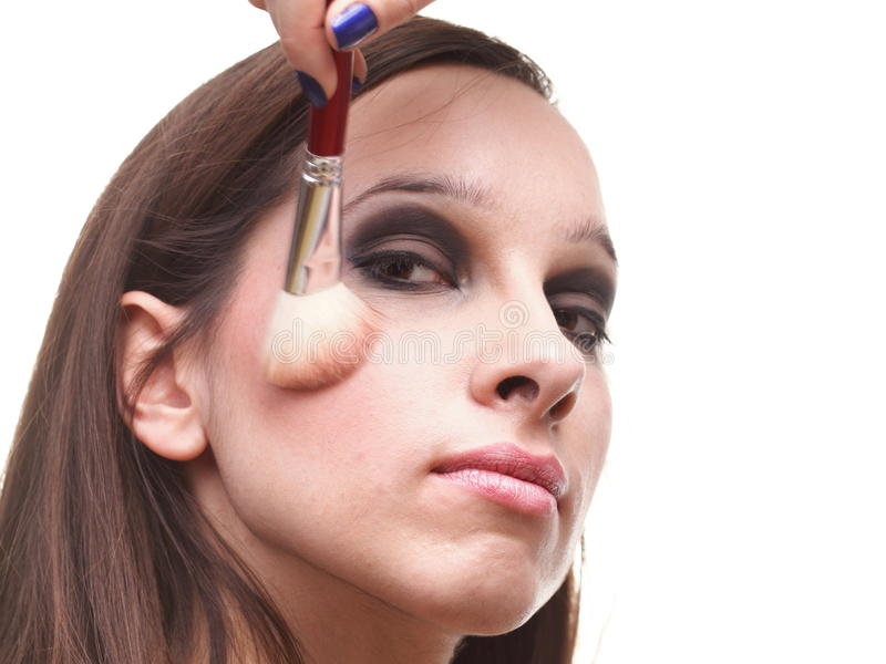 Brunette Woman Applying Powder With A Brush Stock Photo