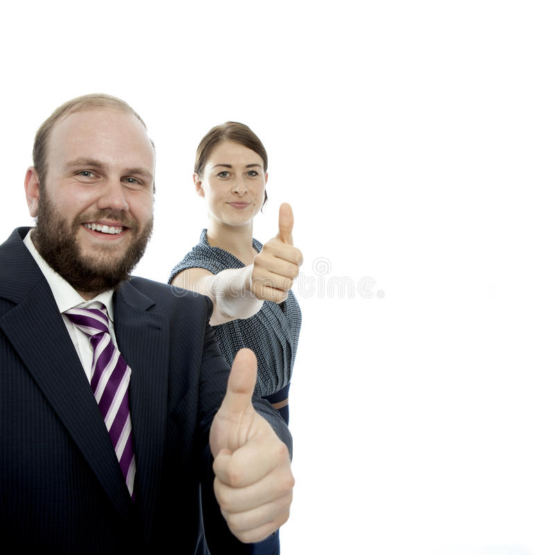 Brunette woman and beard business man thumb up