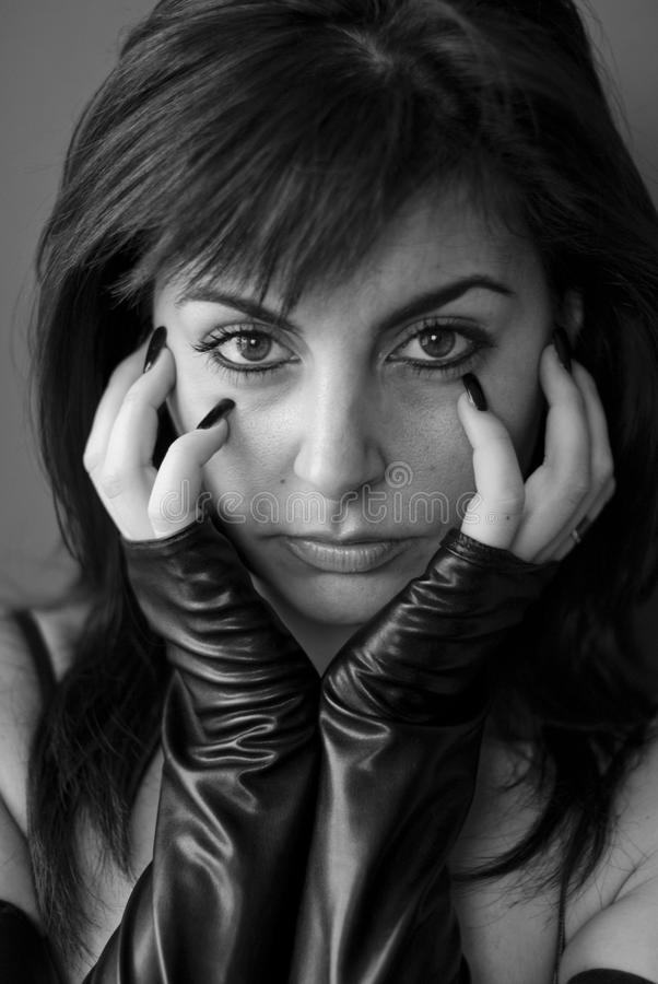 Brunette woman in black stock image