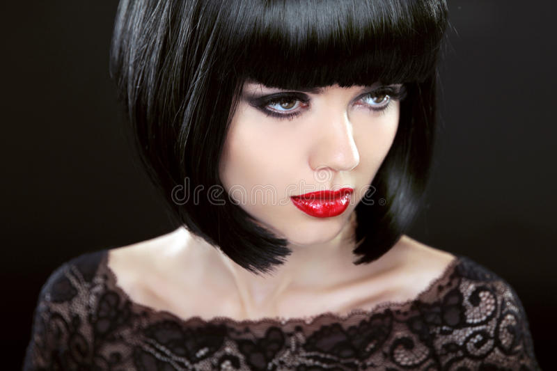 Brunette Woman With Black Short Hair. Haircut. Hairstyle