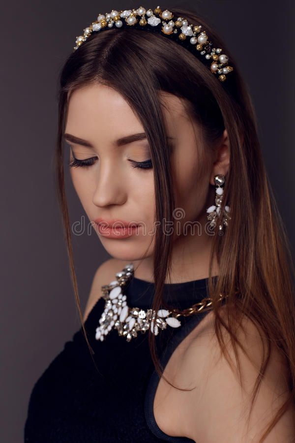 Brunette woman with bright evening makeup with luxurious bijou stock photo