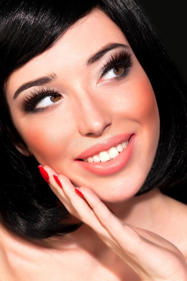 Brunette woman with bright makeup stock image