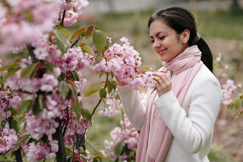 Brunette woman enjoying spring day in park stock photos