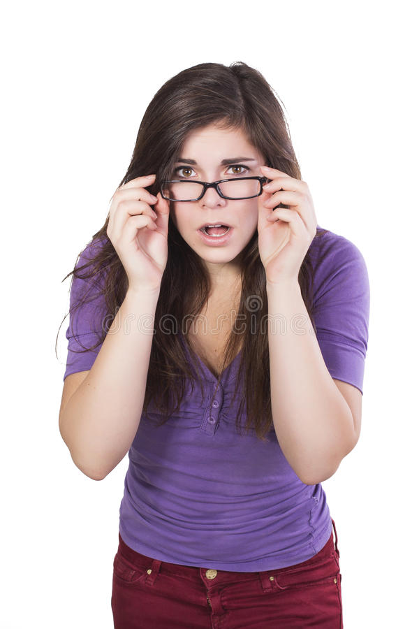 Brunette woman in glasses peering in amazement royalty free stock photos