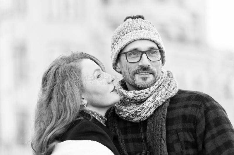 Brunette woman going kissing man. woman looking to guy. Brunette women going kissing man. women looking to guys face. Portrait of happy couple. Bearded guy in stock photos