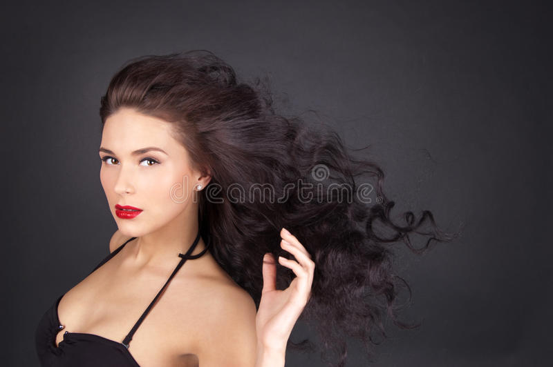 Download Brunette Woman With Her Hair In Movement Stock Photo - Image: 19788344