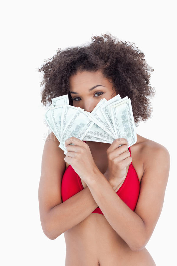 Brunette Woman Hiding Her Face Behind Two Fans Of Notes Stock Images