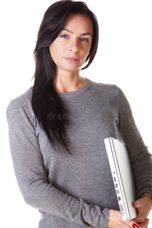 Brunette woman hug laptop computer stock photos