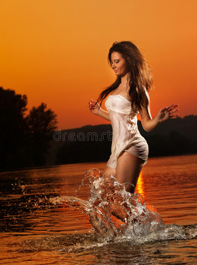Free Brunette Woman In Swimsuit Running In River Water. Young Woman Playing With Water During Sunset. Beautiful Woman Stock Photo - 52379270