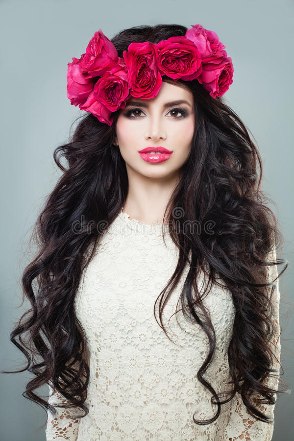 Brunette Woman with Long Permed Hair, Beautiful Makeup and stock photo
