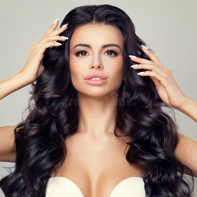 Brunette Woman With Long Shiny Wavy Hair. Beautiful Model