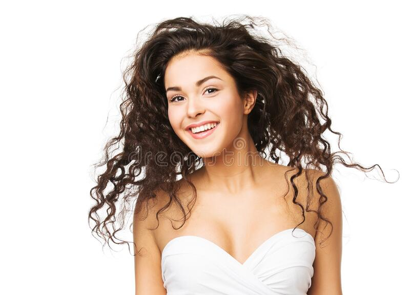 Brunette Woman with Long Wavy Hair. Beautiful Happy Smiling Girl Portrait, Curly Hairstyle on White stock images