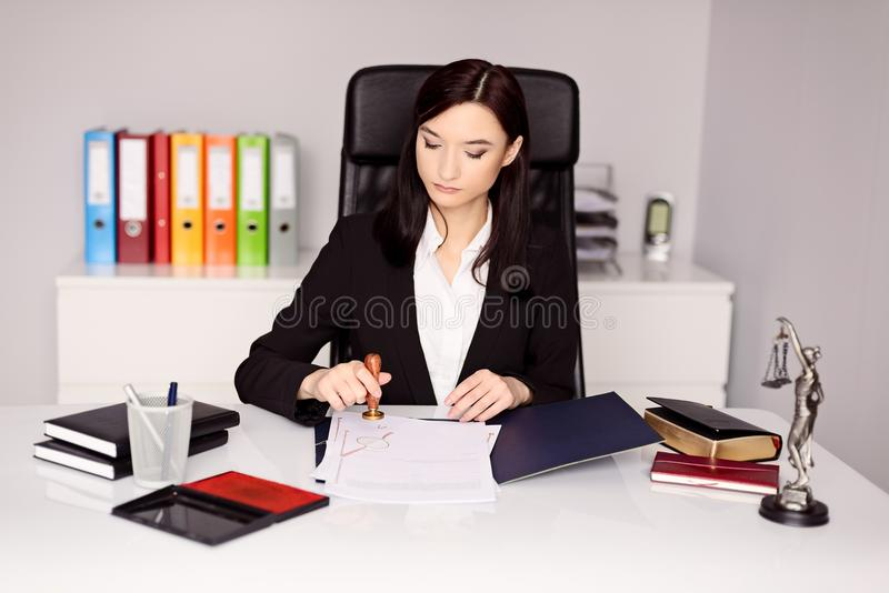 Brunette woman Notary Public notarizes notary act stock photos