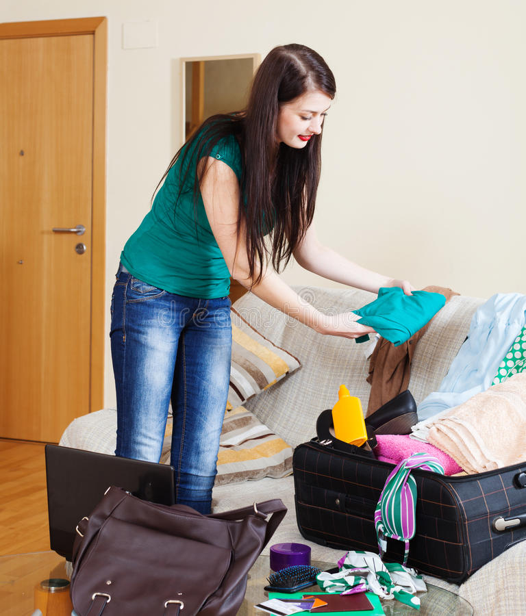 Download Brunette Woman Packing Suitcase Stock Photo - Image: 43557569