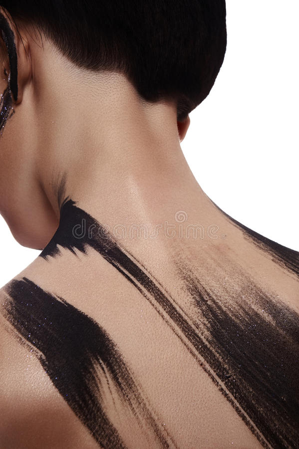 Brunette Woman with Paint Strokes on her Back royalty free stock photos