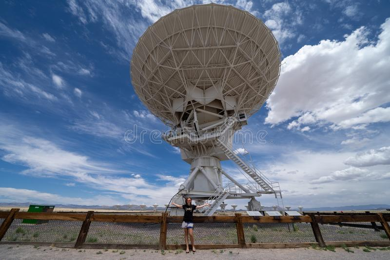 Brunette woman poses near the Very Large Array in New Mexico stock photo
