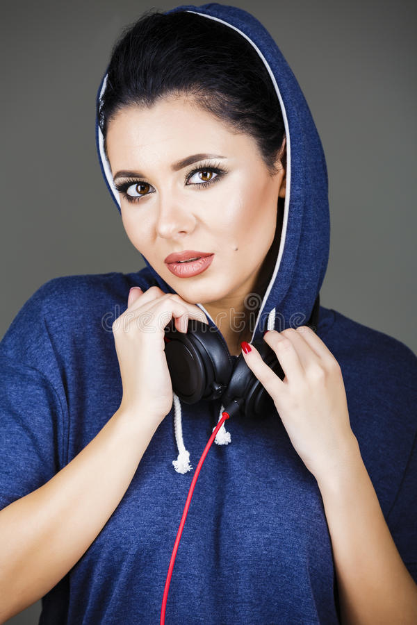 Brunette woman posing with headphones. Portrait beautiful brunette woman posing with headphones stock image