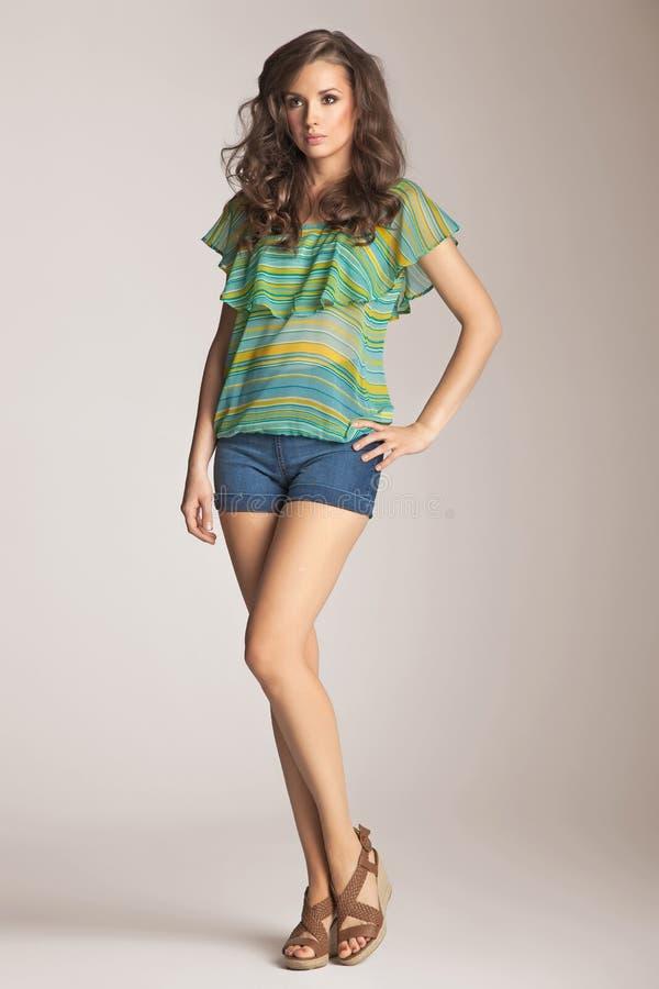 Brunette model presenting spring fashion stock photo