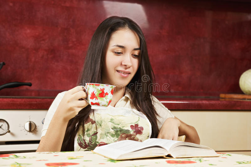 Brunette woman reading book royalty free stock photography