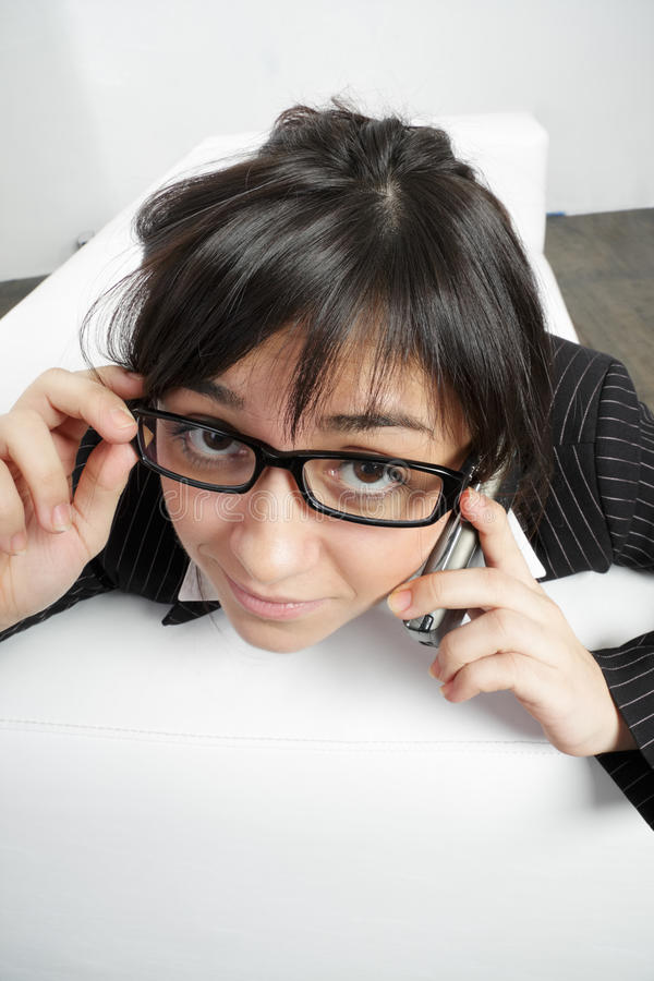 Brunette woman in spectacles with cellphone royalty free stock image