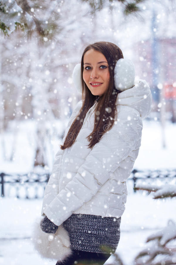 Brunette woman standing in winter park royalty free stock photography