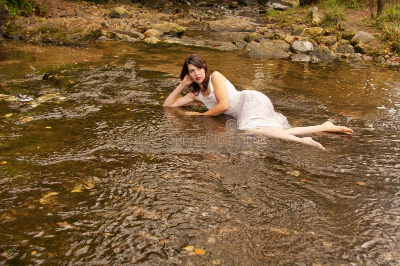 Download Brunette woman in stream stock photo. Image of creek - 27540712