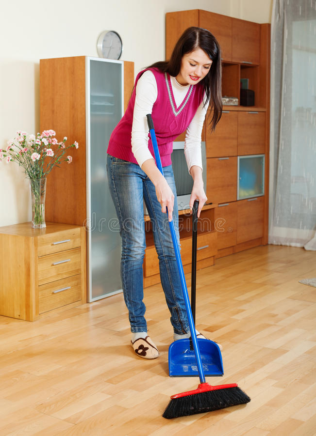 Brunette Woman Sweeping The Floor Stock Photo Image