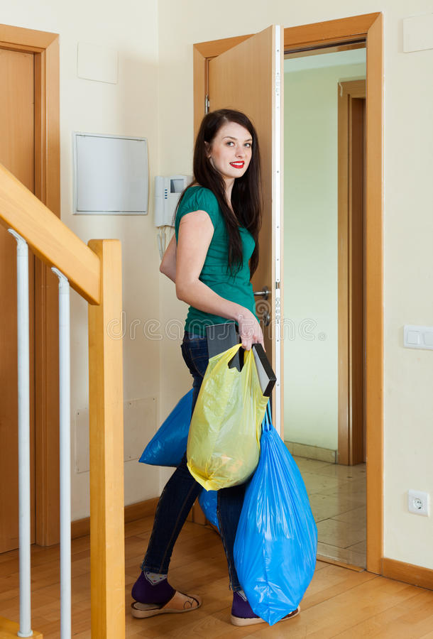 Brunette woman taking away the garbage stock image