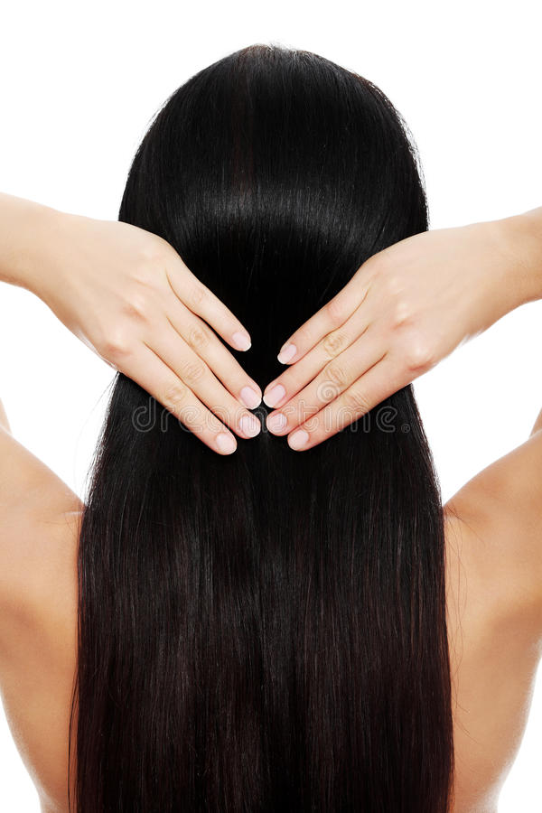 Brunette woman touching her hair stock photo