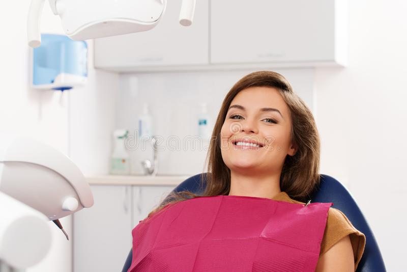 Brunette woman visiting dentist stock images