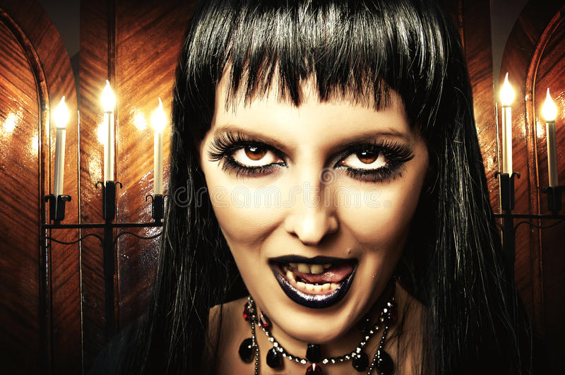 Brunette woman witch, Gothic make-up. Gothic brunette woman witch with dark make-up and evil eyes stock images