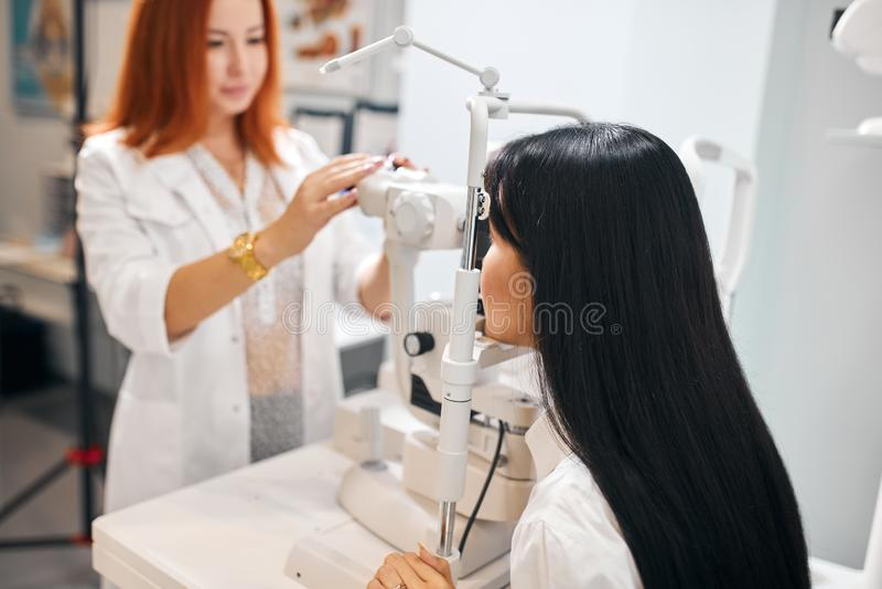 Brunette woman having eyes examination. Brunette women having eyes examination, health and eyes care. close up photo royalty free stock photo