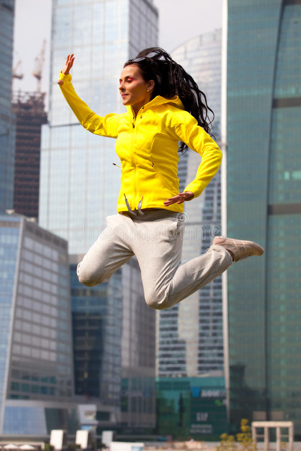 Download Brunette In A Yellow Blazer Jumping Stock Photo - Image: 24081206