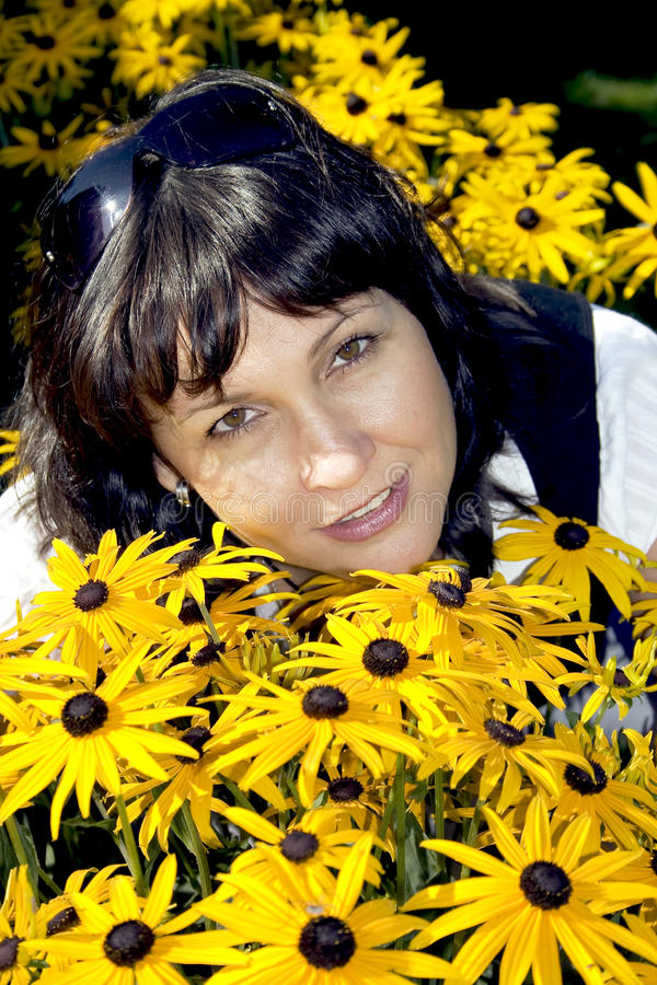 Download Brunette in yellow flowers stock photo. Image of close - 10558944