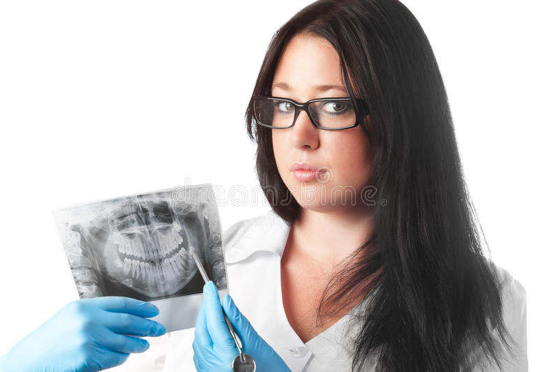 Brunette young female dentist holding x-ray