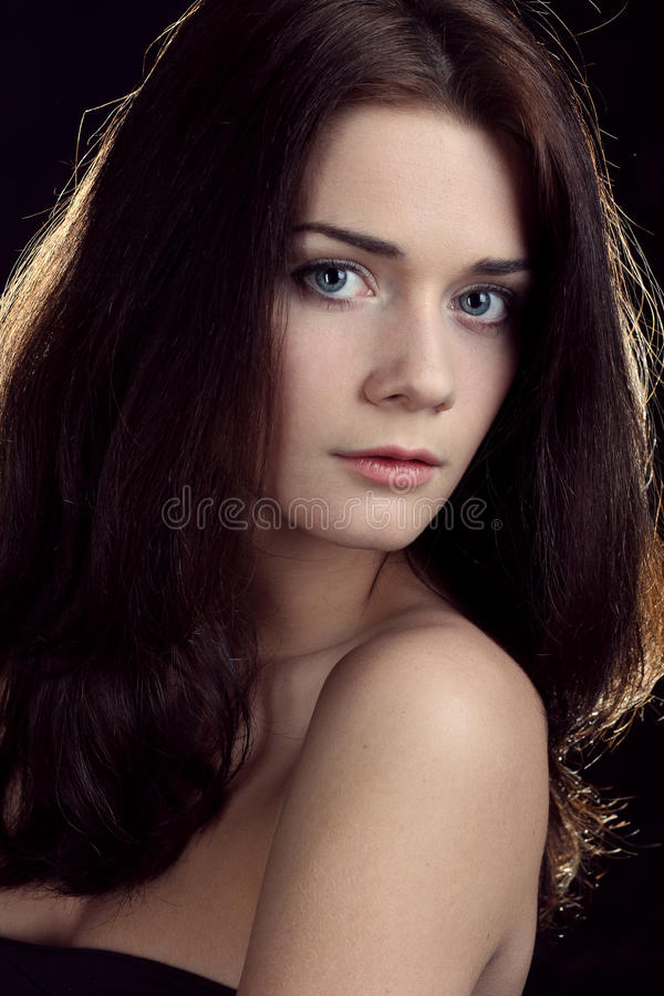 Brunette young woman royalty free stock photography