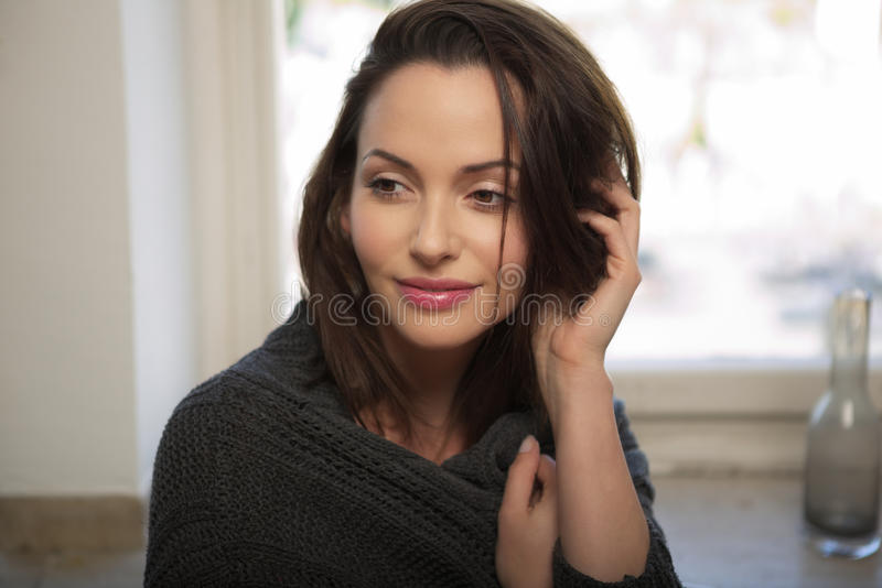Brunette young woman wearing a cardigan royalty free stock photo