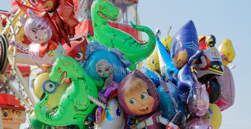 Brunswick, Lower Saxony, Germany - April 15, 2018: Close-up of colourful balloons tied together. For sale with funny comic figures filled with the inert gas royalty free stock image