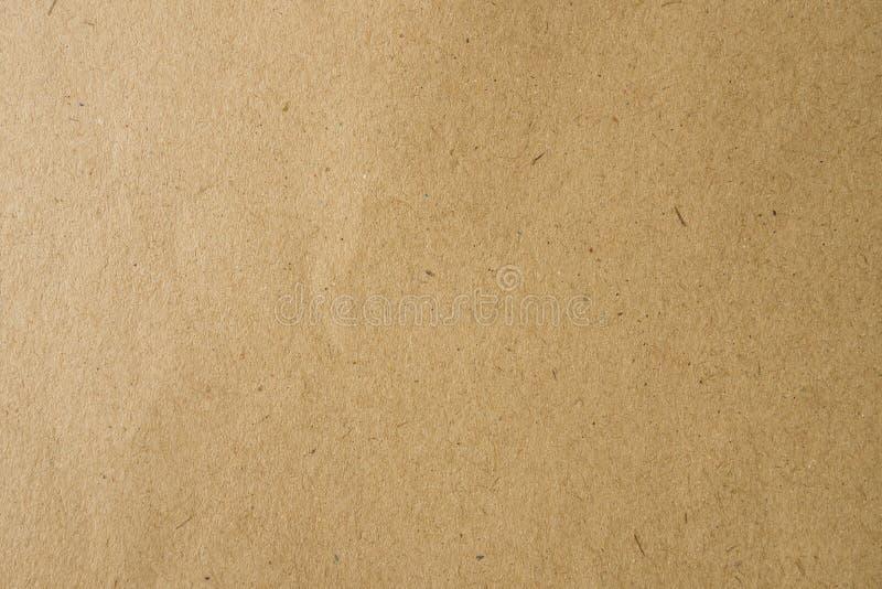 Brunt hantverkpapper för bakgrund arkivbilder
