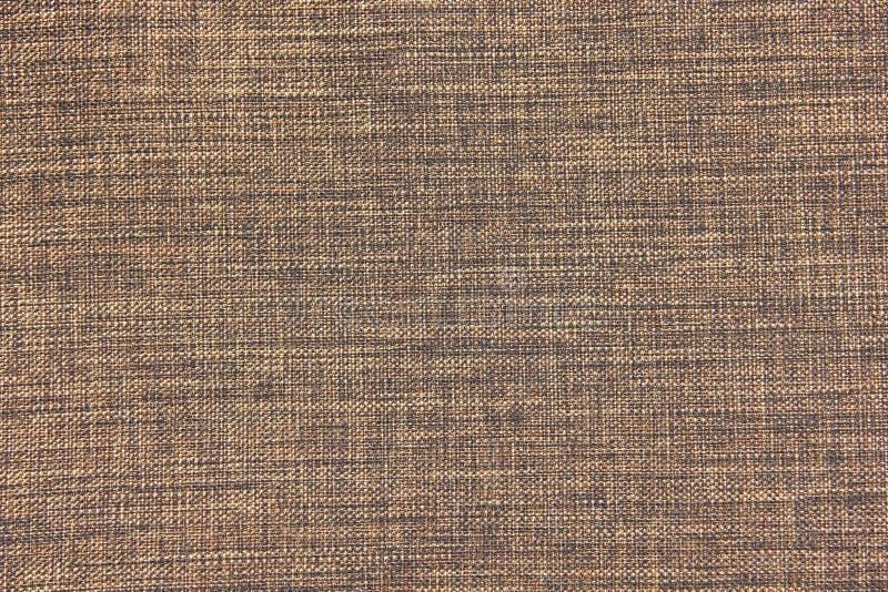 Brunt och Tan Upholstery Cloth Background arkivbild