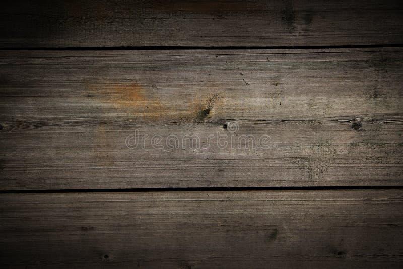 Brunt trä texturerad bakgrund royaltyfria bilder