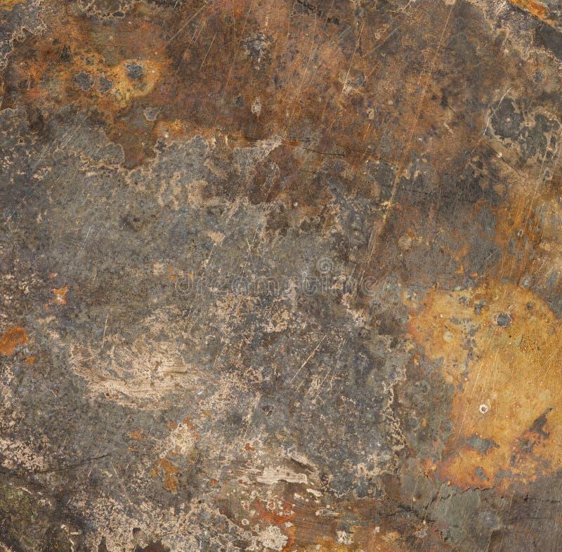 Bruntet rostar belägger med metall bakgrund arkivbild