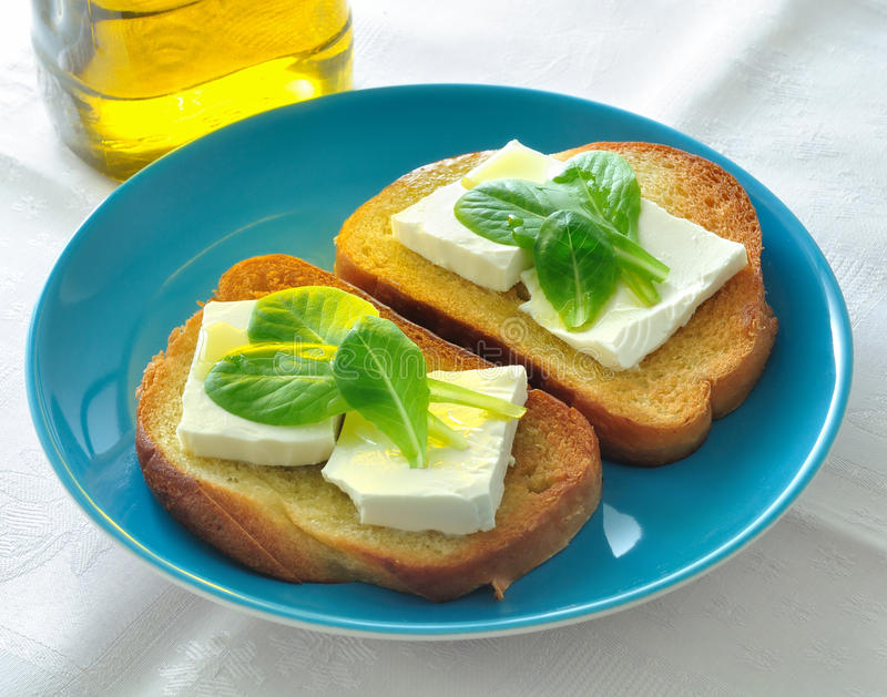 Bruschetta. With cheese and herbs royalty free stock photos