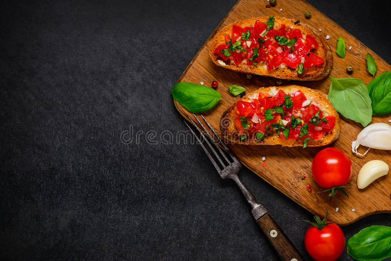 Bruschetta Antipasto with Tomato and Basil on Copy Space royalty free stock image